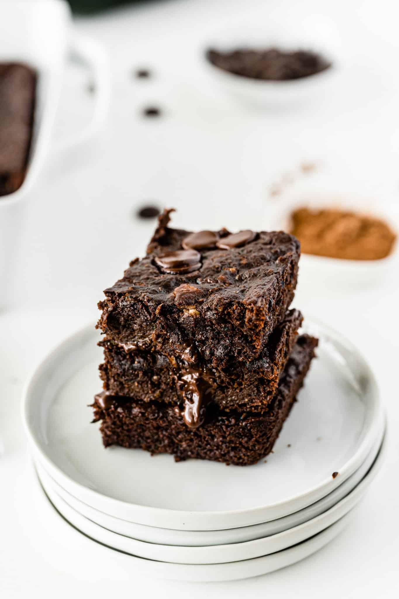 a stack of brownies on a plate