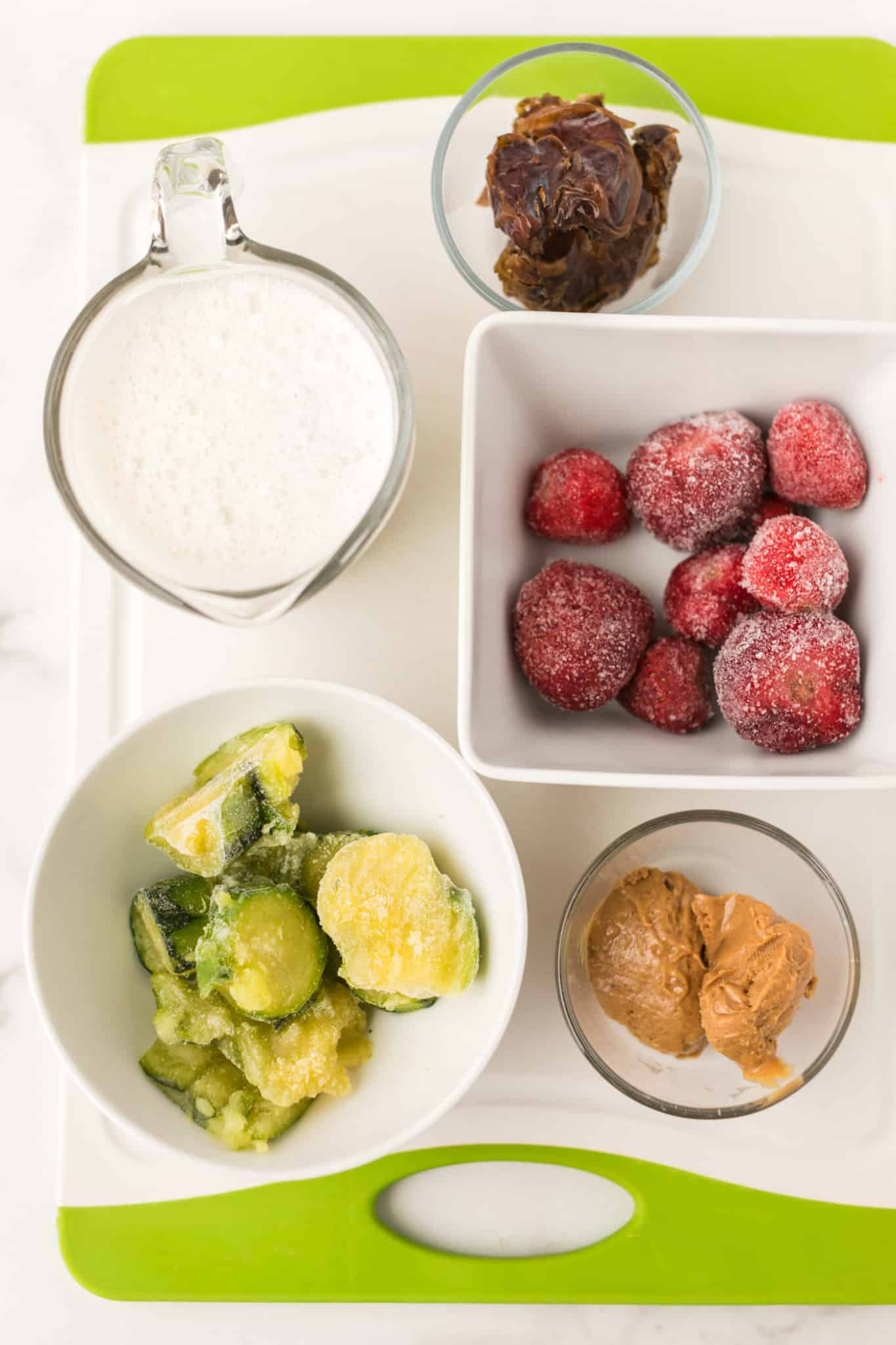 ingredients for strawberry and frozen zucchini chunk smoothie