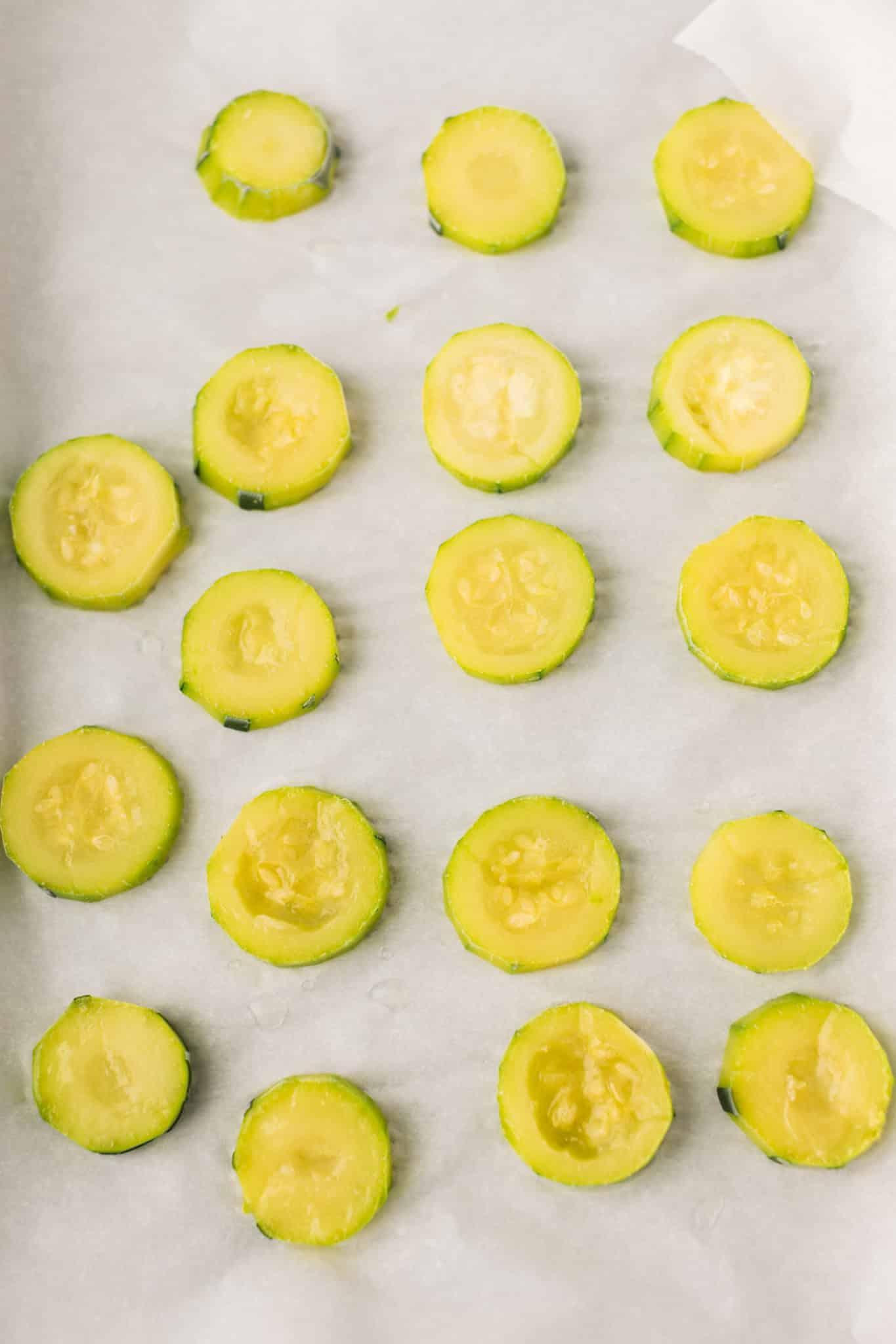 frozen zucchini slices on a baking sheet