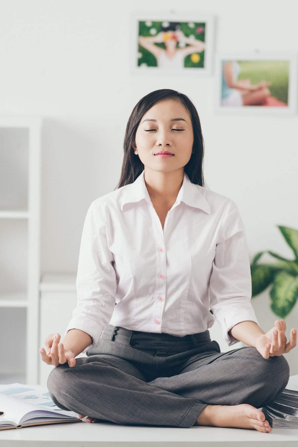 woman meditating at the office