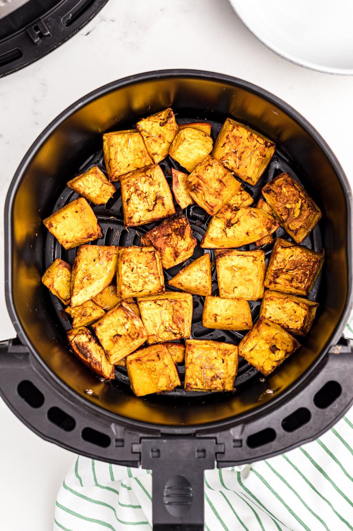 roasted pumpkin chunks in an air fryer