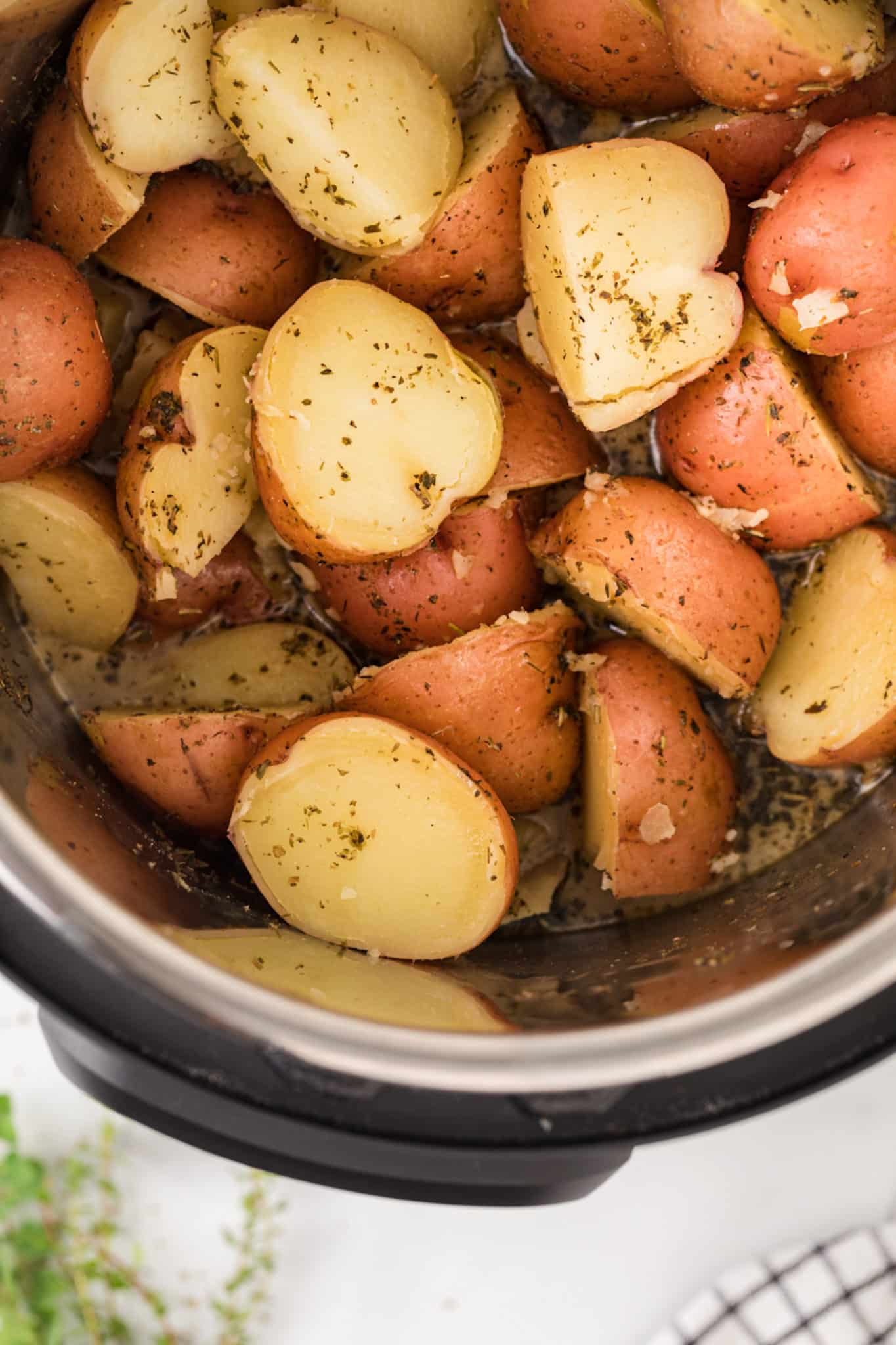 cooked red potatoes with seasonings inside instant pot