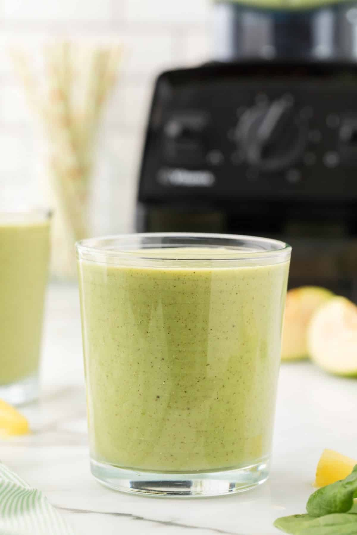 glass of green smoothie on a table