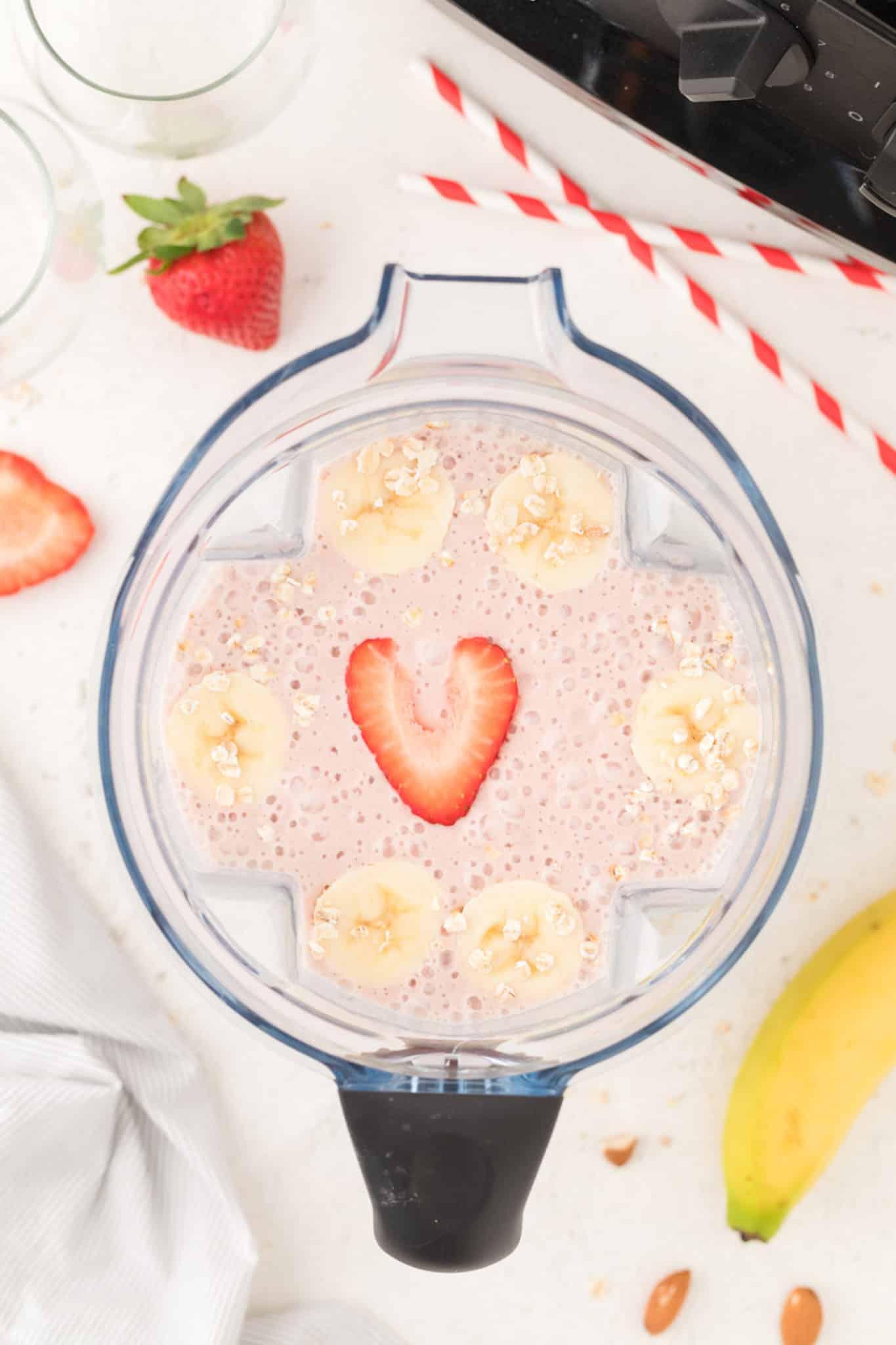 pink smoothie inside of a blender