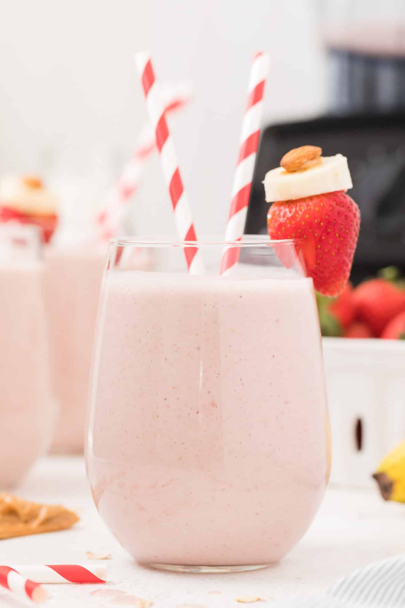 strawberry banana oatmeal smoothie served in a glass on a table