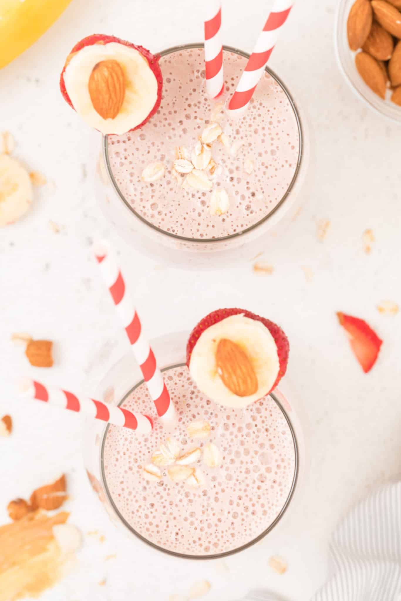 two glasses of strawberry oatmeal banana smoothie