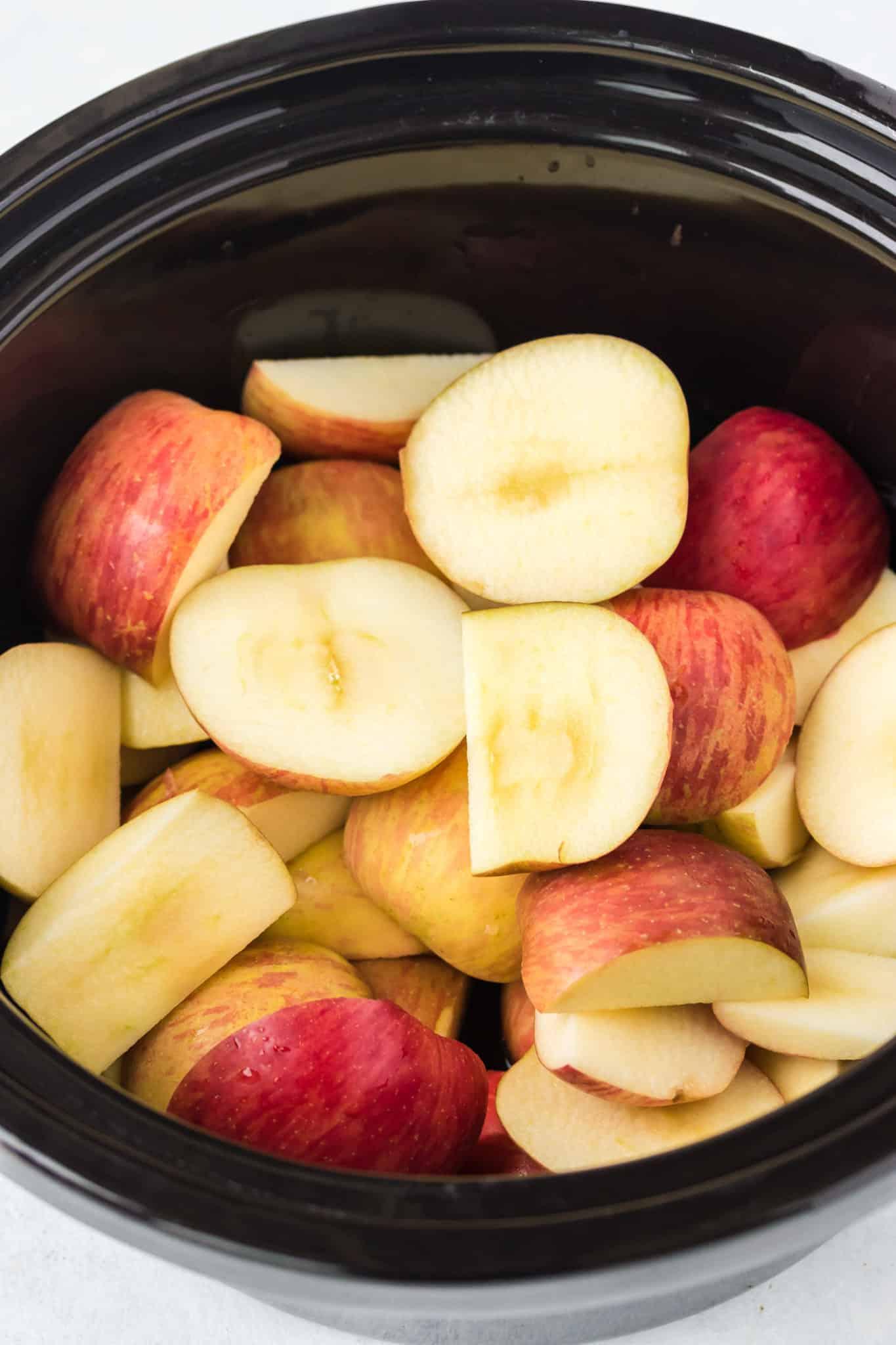 sliced apples inside of a crockpot