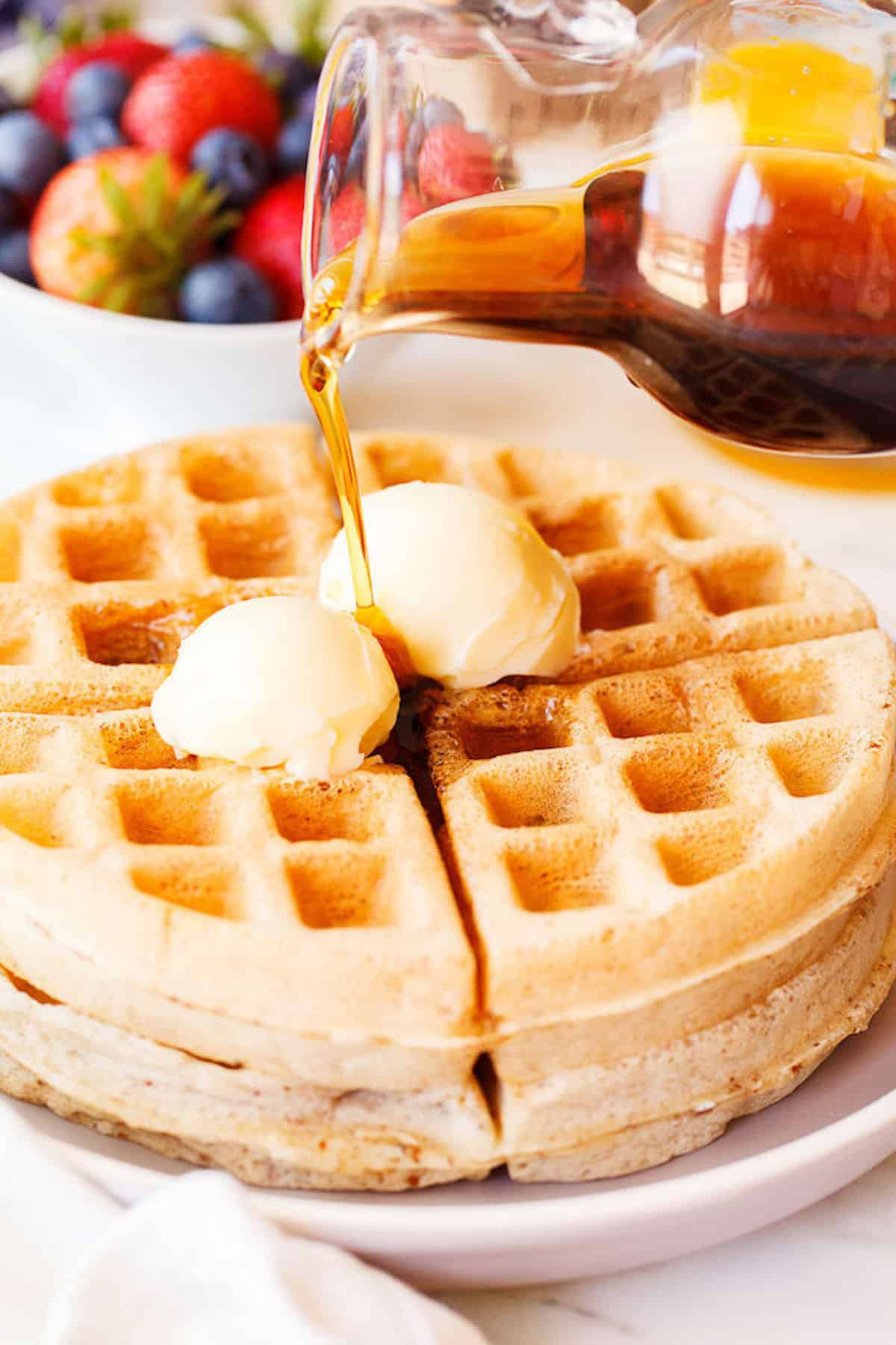 waffles served with butter and syrup