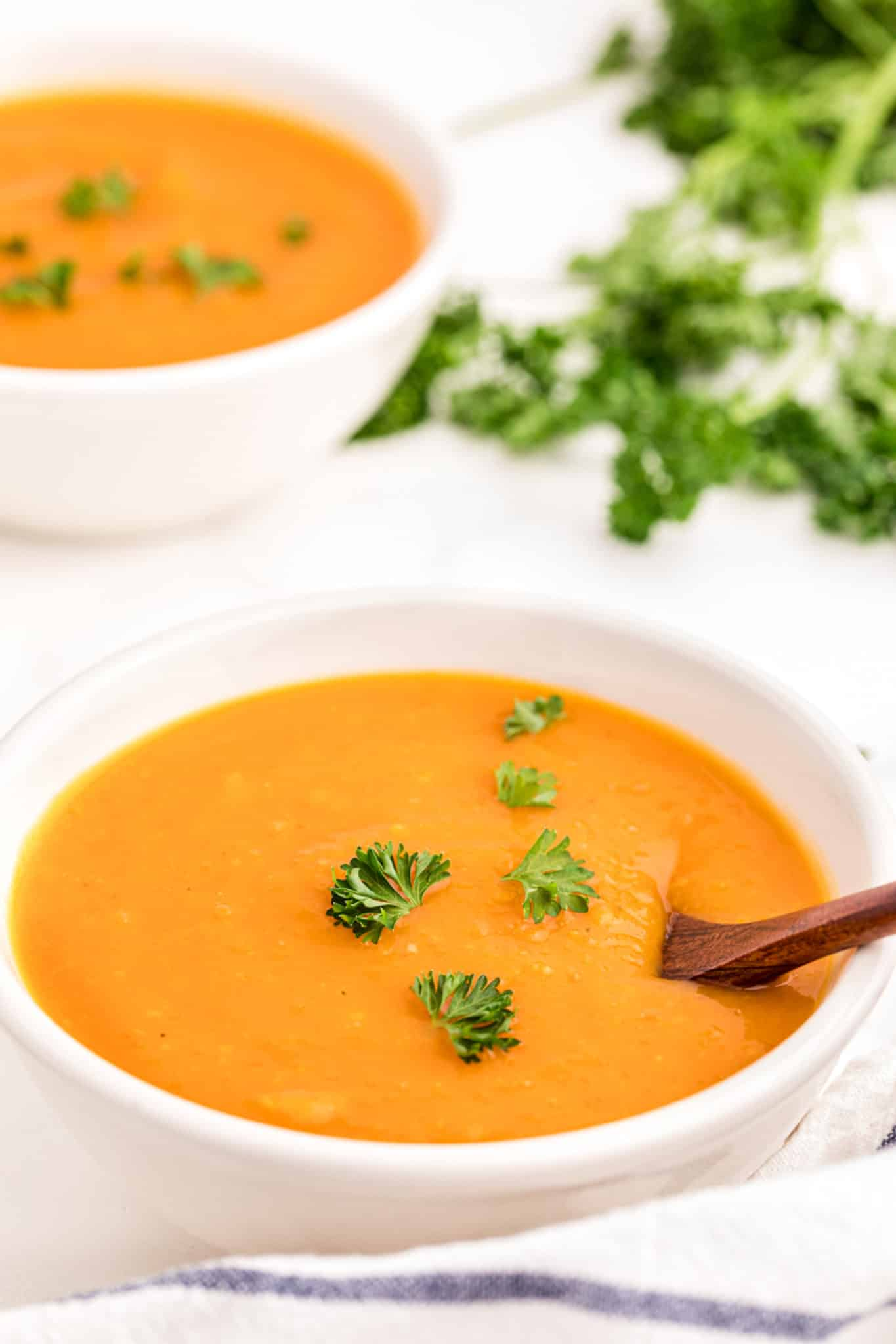 butternut squash soup served in two white bowls