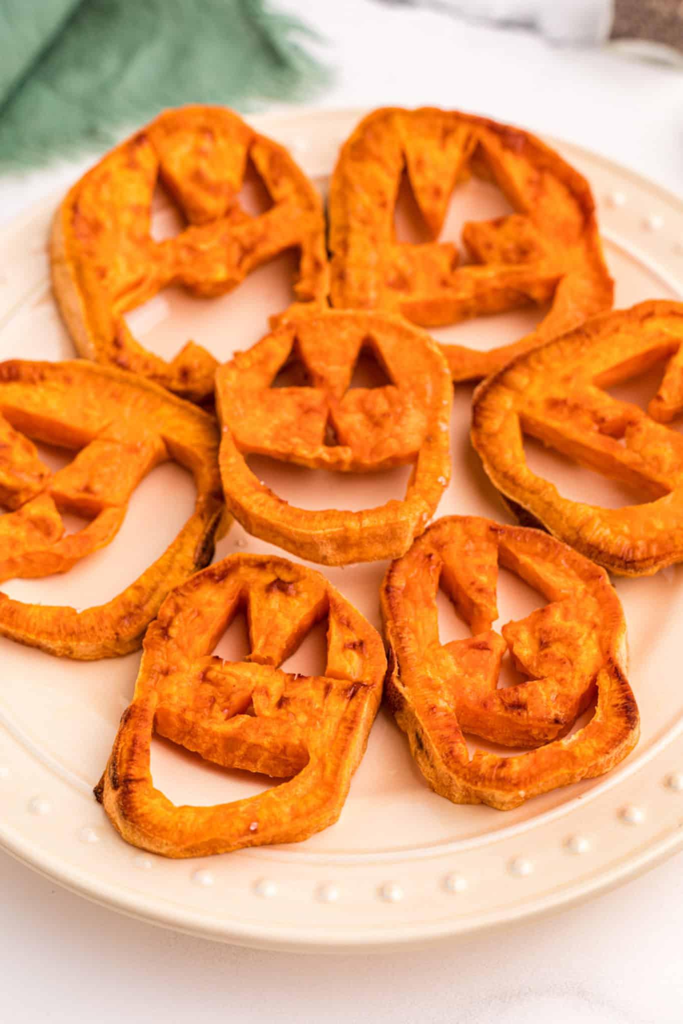 sweet potato jack o'lanterns on a plate
