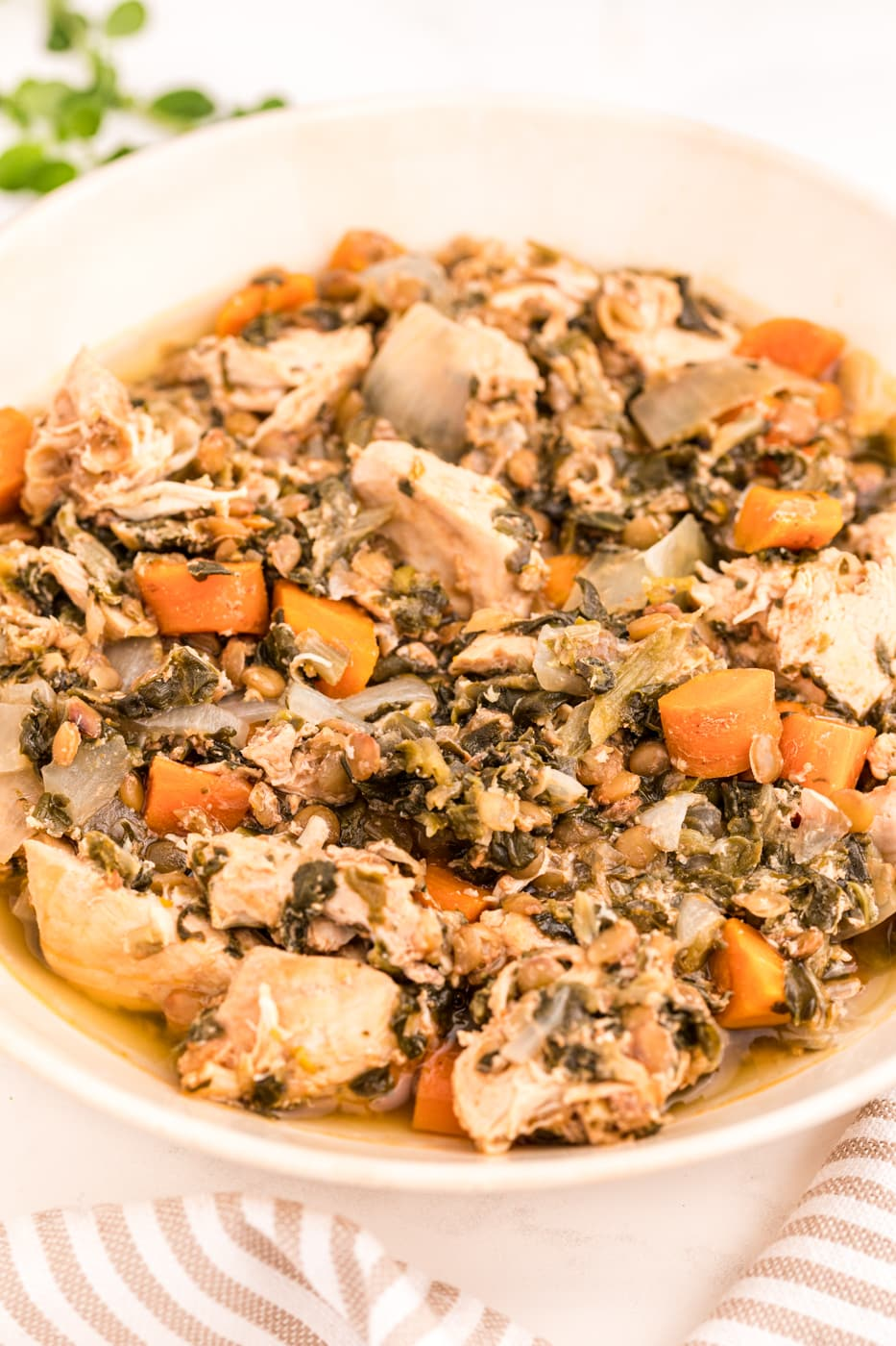 bowl of cooked chicken stew with spinach