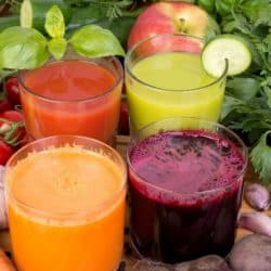 colorful veggie juices on a table