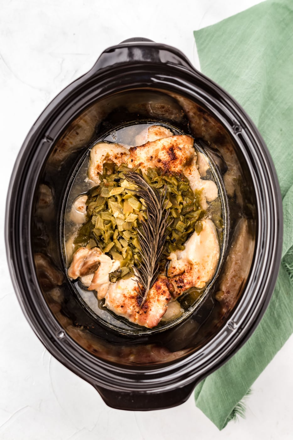 slow cooker with chicken and green chiles