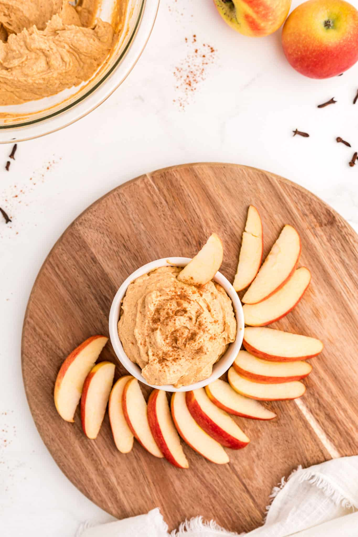 dip with apples on table