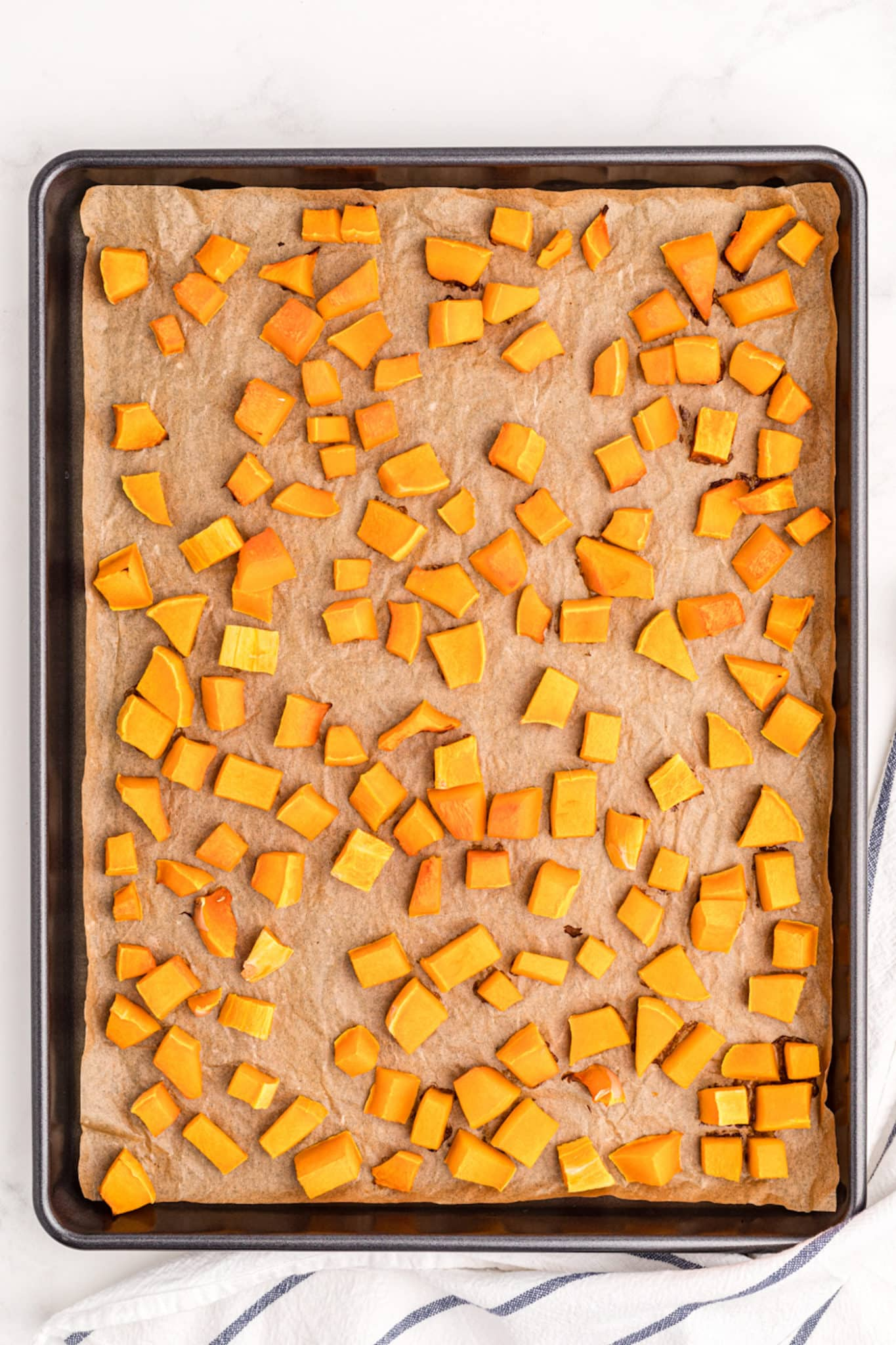 roasted squash pieces on a baking sheet